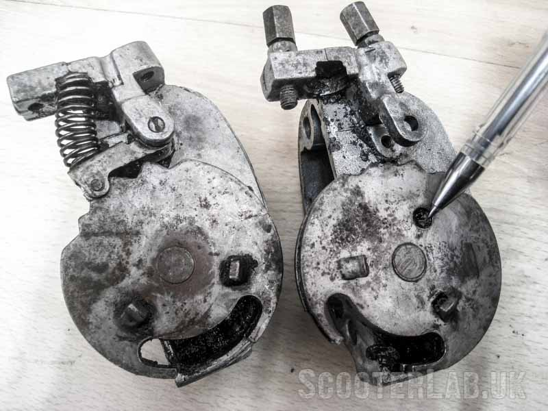 The early type (pre-1984) selector box on the left has a plain wheel. Later genuine Piaggio Italian EFL types (right) are USUALLY identified by a circular indent in the wheel.