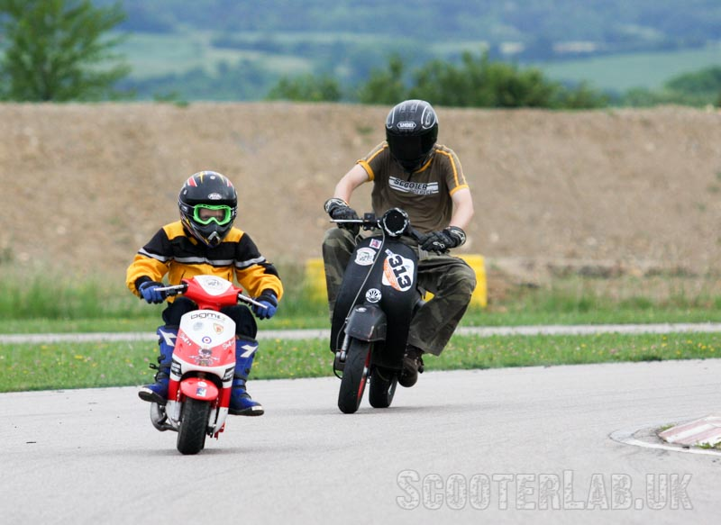 Sticky follows the Twig around Mirecourt on his Vespa SS90 at Scootentole race meeting in France 2009