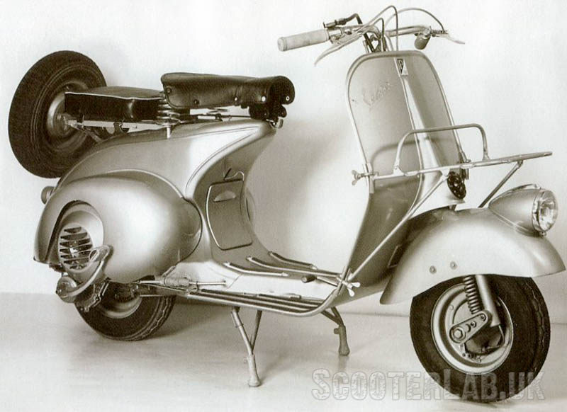 The small steel patch behind the front mudguard was a repair section added to weak Vespa frames made in the USA.