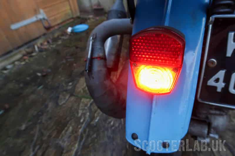 A bright rear light, even off a normal 12V AC Vespa electrical system