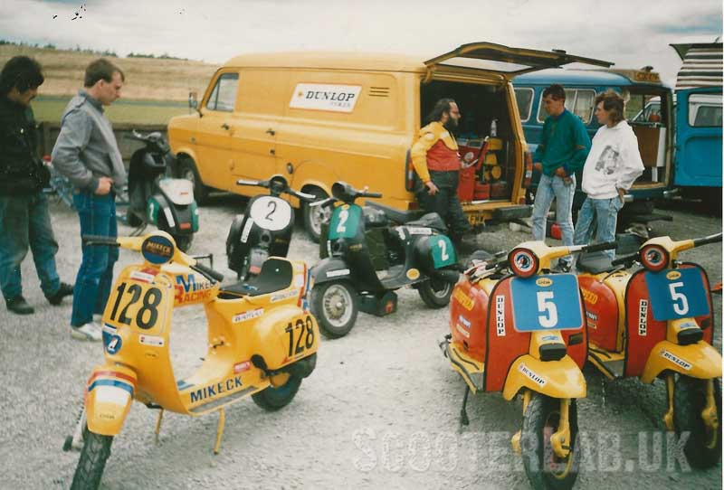 The late 'Turbo' Terry Frankland in Team Taffspeed leathers surrounded by sacrificial Vespa 90ss'